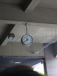 A crooked clock hung above the tour entrance